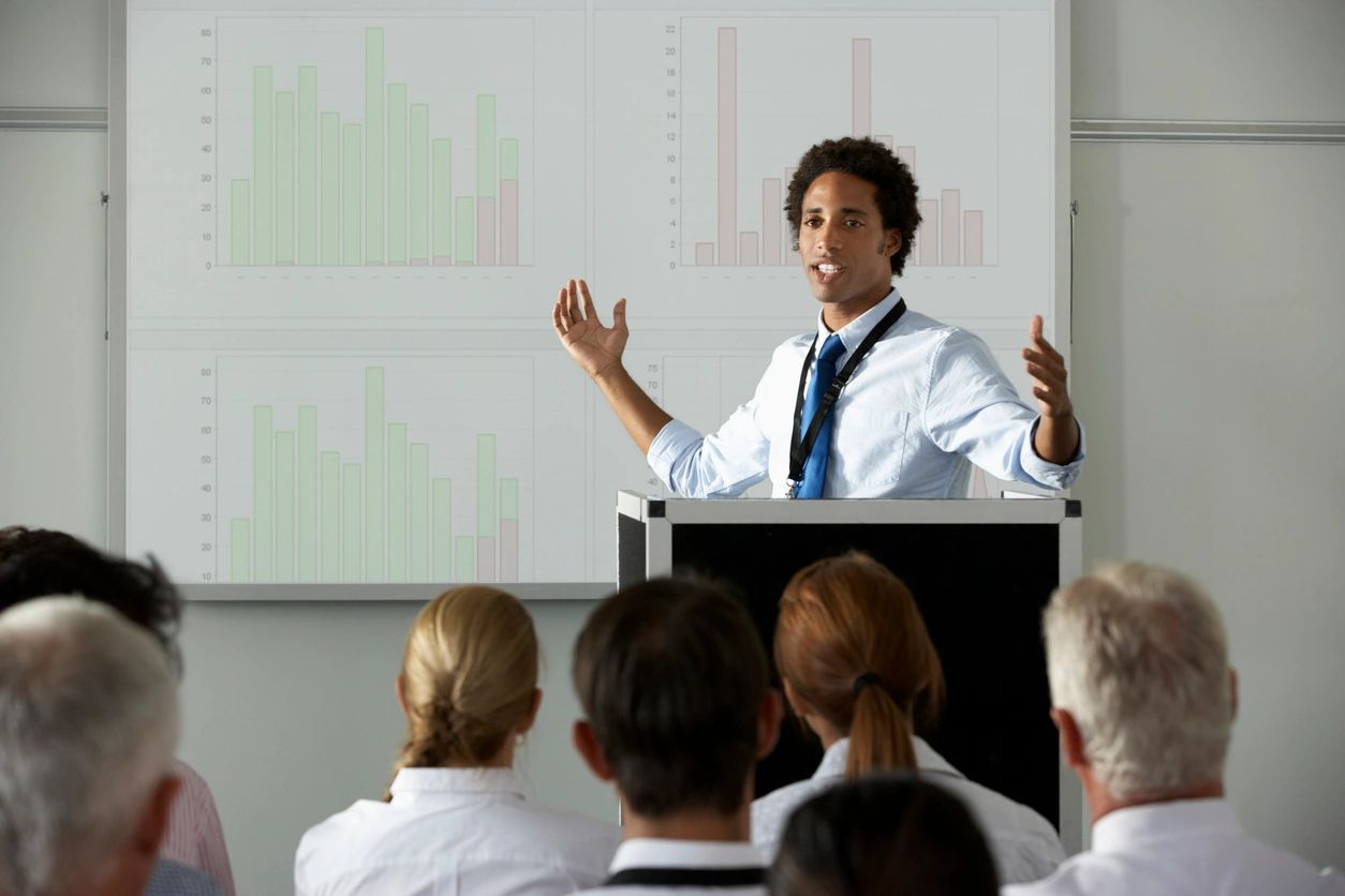 Management Consultant teaching a group of executives